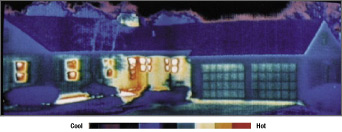 Thermal photograph of ranch style house shows heat escaping through windows, doors, and front porch.
